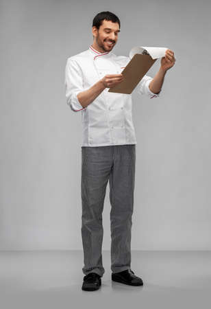 happy smiling male chef with clipboard