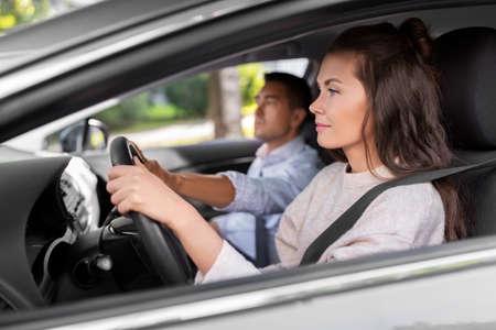car driving school instructor teaching woman Stock Photo