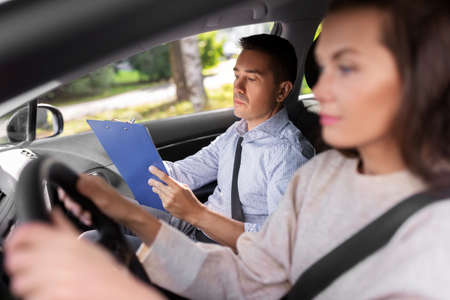 car driving school instructor and young driver