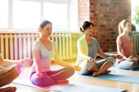 group of women meditating at yoga studio