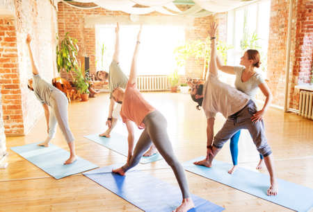 group of people doing yoga exercises at studio Stock fotó