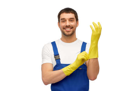male worker or cleaner in overall wearing gloves