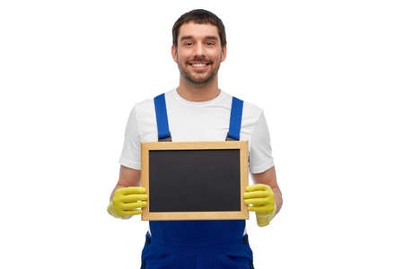 smiling worker or male cleaner showing chalkboard
