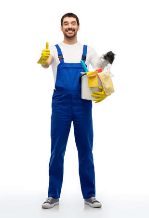 cleaner with cleaning supplies showing thumbs up Standard-Bild