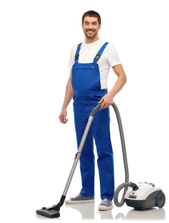 male worker cleaning floor with vacuum cleaner Stockfoto