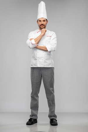 happy male chef in toque Standard-Bild