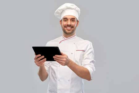 happy smiling male chef with tablet pc computer