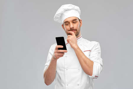 male chef with smartphone