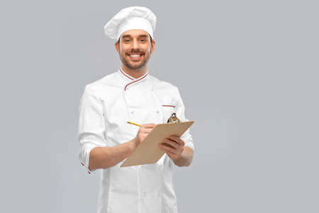 happy smiling male chef with clipboard and pencil Standard-Bild
