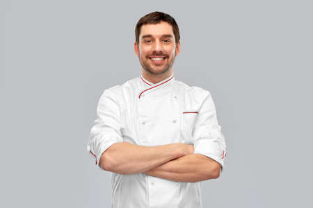happy smiling male chef with crossed arms