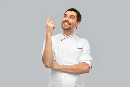 happy smiling male chef pointing finger up