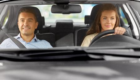car driving school instructor teaching woman