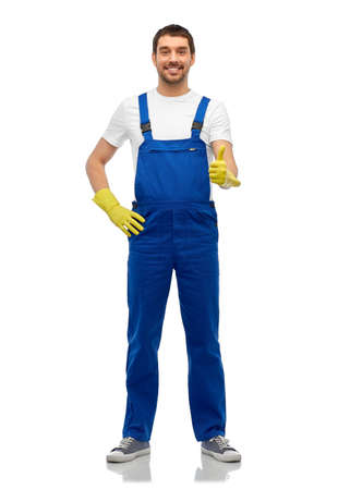 happy male worker or cleaner in overall and gloves
