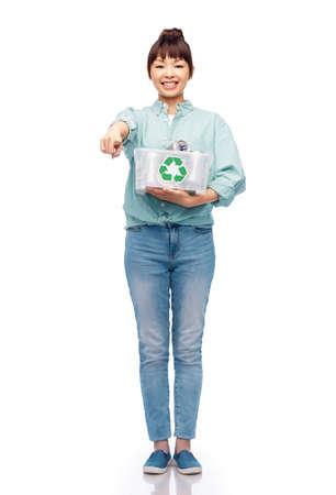 smiling young asian woman sorting metallic waste Stock Photo