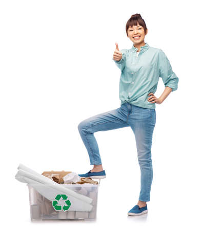 happy smiling asian woman sorting paper waste
