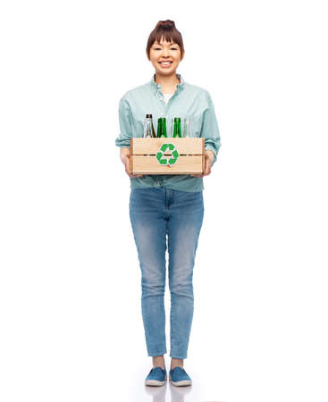 smiling young asian woman sorting glass waste