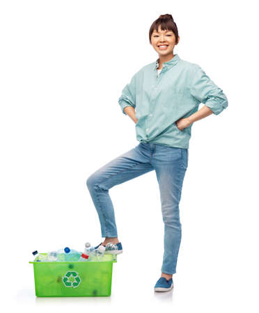 smiling young asian woman sorting plastic waste