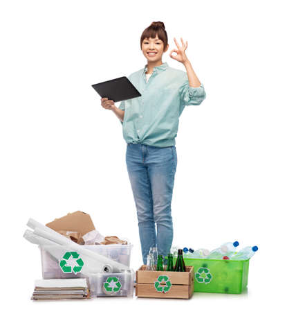 smiling asian woman with tablet pc sorting waste