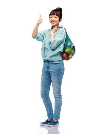woman with food in string bag showing thumbs up