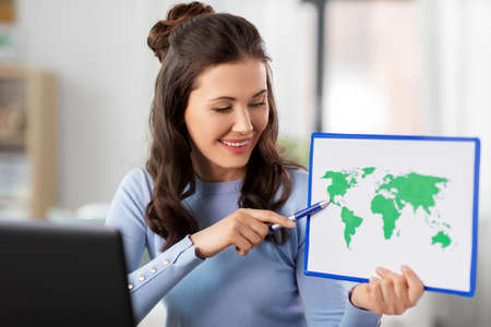 teacher with world map having online class at home