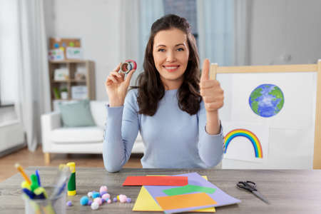 teacher having online class of arts and crafts Stock Photo