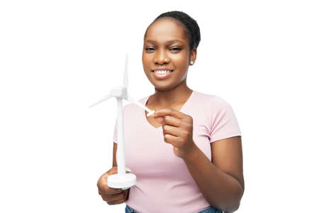 happy african american woman with toy wind turbine
