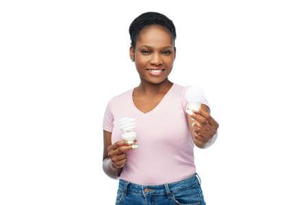 african american woman holding lighting bulbs Stock Photo