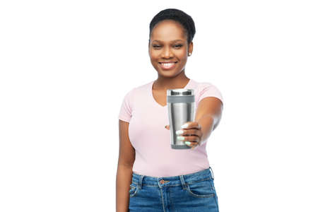 woman with thermo cup or tumbler for hot drinks