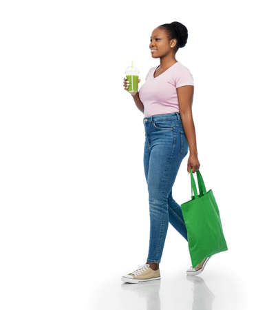happy woman with drink and food in reusable bag Stock Photo