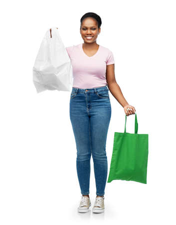 woman comparing reusable and plastic bags Stock Photo