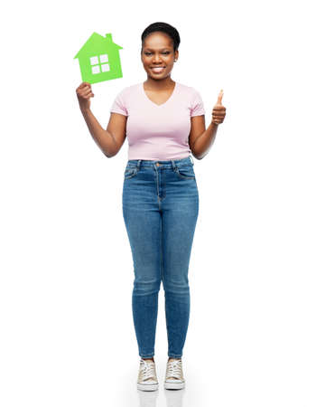 smiling african american woman holding green house