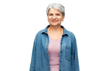 portrait of smiling senior woman in denim shirt