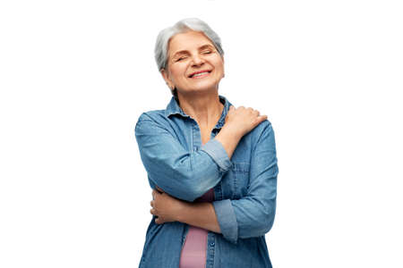 portrait of smiling senior woman in denim shirt Stock Photo