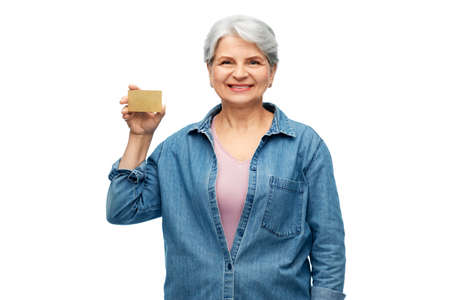 portrait of smiling senior woman with credit card Stock Photo