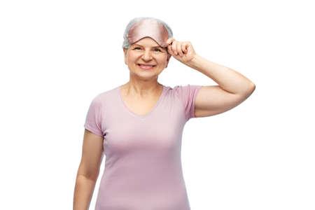 senior woman in pajamas and eye sleeping mask Stock Photo