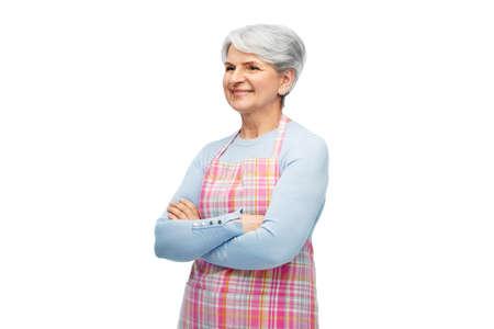 portrait of smiling senior woman in apron