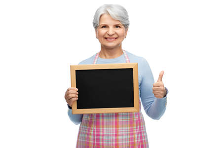 old woman in apron with menu showing thumbs up