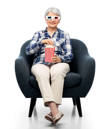 old woman in 3d glasses with popcorn watches movie