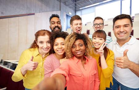international students and teacher taking selfie Фото со стока