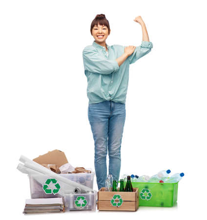 happy woman sorting paper, metal and plastic waste