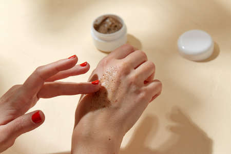 close up of hands applying natural scrub to skin