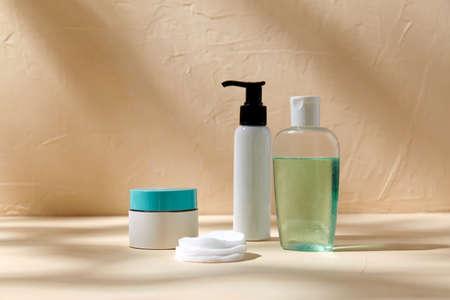 body milk, lotion, moisurizer and cotton pads Фото со стока