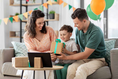 happy family giving present to little son at home