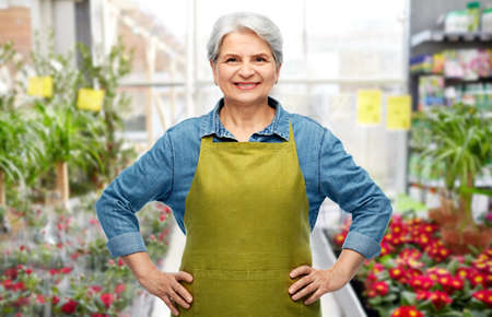 smiling senior woman in gardening center