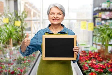 senior gardener with chalkboard showing thumbs up