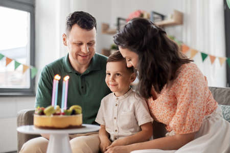 happy family with birthday cake at home