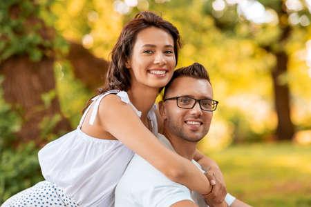 happy couple hugging at summer park Foto de archivo