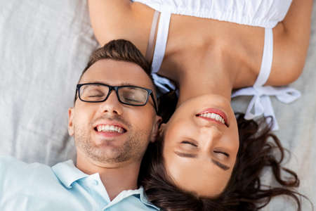 happy couple on picnic blanket