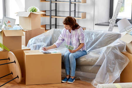 asian woman moving to new home and counting money