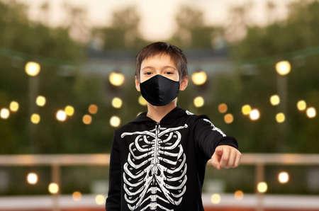 boy in mask and halloween costume of skeleton Zdjęcie Seryjne